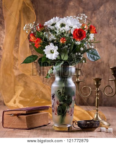 Still Life With A Bouquet Of Flowers, A Book And A Candlestick
