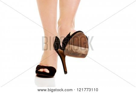 Woman's leg in high heels trying to trample something