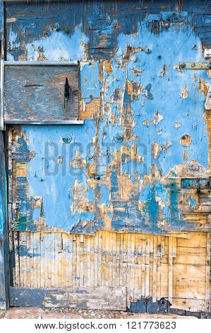Wooden door deteriorated due to exposition to the wind and salt air