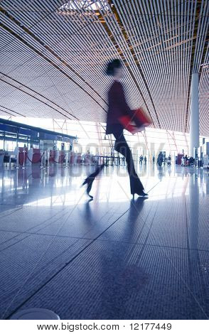 Woman hurrying in airport.