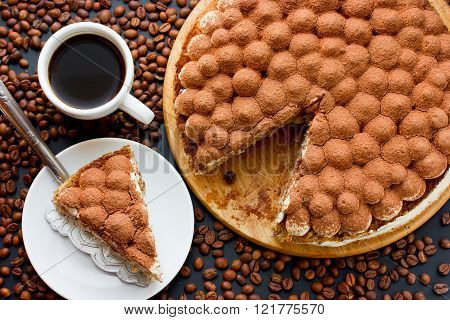 Traditional Italian dessert cake tiramisu with coffee and coffee beans top view