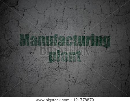 Manufacuring concept: Manufacturing Plant on grunge wall background