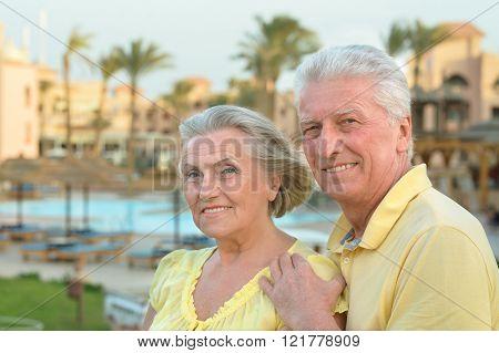 Senior couple near pool