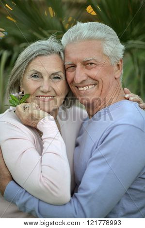 smiling old couple with flowers