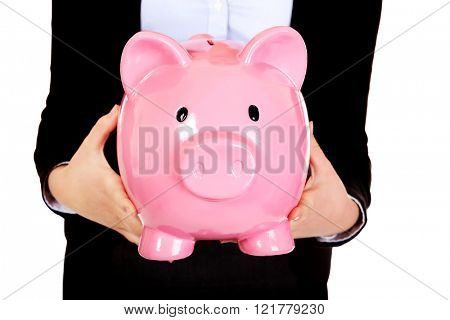 Young business woman holiding piggybank