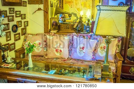 ODESSA UKRAINE - MAY 18 2015: The sofa decorated by beautiful pillows in retro style in local cafe on May 18 in Odessa.