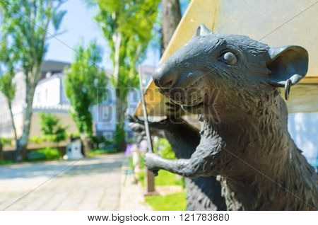 ODESSA UKRAINE - MAY 18 2015: The element of the sculpture of the rats that hold the piramid in the courtyard of the Odessa Literary Museum on May 18 in Odessa.