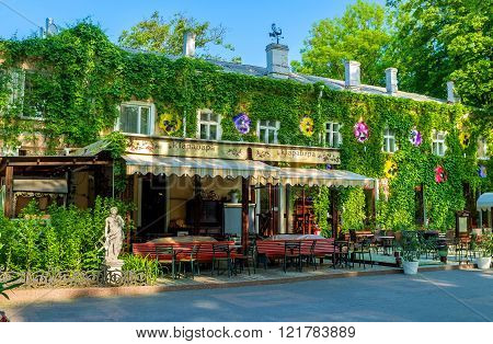 ODESSA UKRAINE - MAY 18 2015: The local restaurant in City Garden located in old ivy-covered building on May 18 in Odessa.