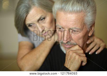 Mature couple near wall