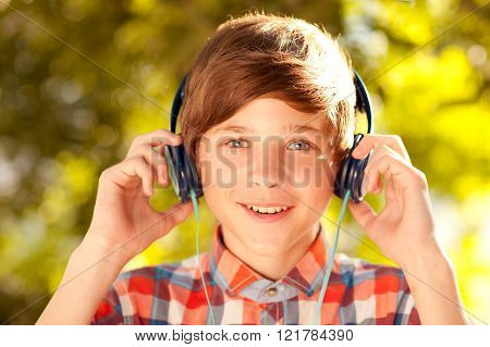 Teen boy listening to music