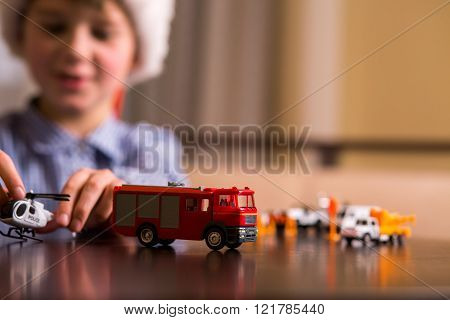 Kid with toy police helicopter.