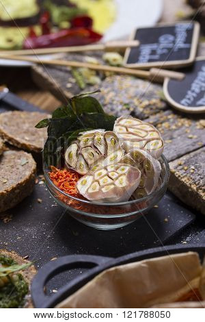 Sliced Garlic With Many Else Spices Over Rustic Background