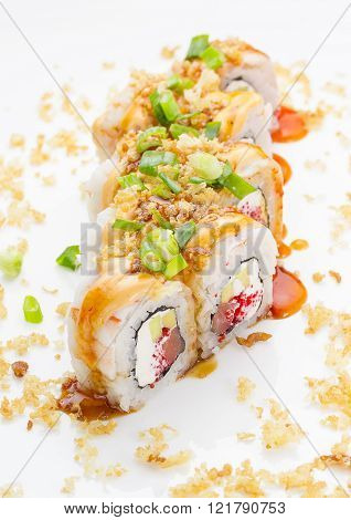 Sushi With Shrimp Avocado Salmon And Cheese Strewed With Green Onion. Crunch Roll. With Delicious Sa