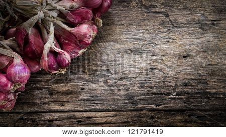 Group of shallot on the wood table.