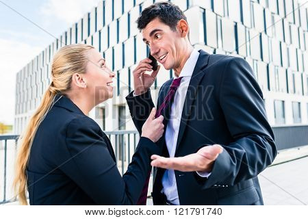 Flirt in the workplace - woman teasing man who is trying to work