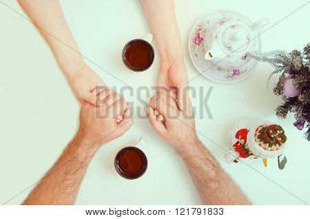 Female And Male Hands With Cups Of Tea