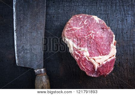 Dry Aged Raw Rib Eye Steak with Kitchen Cleaver