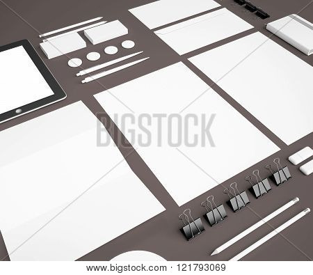corporate identity Mock Up on a gray background. Set includes package, a tube, a pencil, a tablet, a smartphone; icon; clip, business cards, pens, CD, flash card, paper clips, erasers, cup, sticker