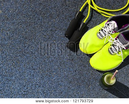 Running Shoes, Jump Rope And Drink Bottle With Green Juice