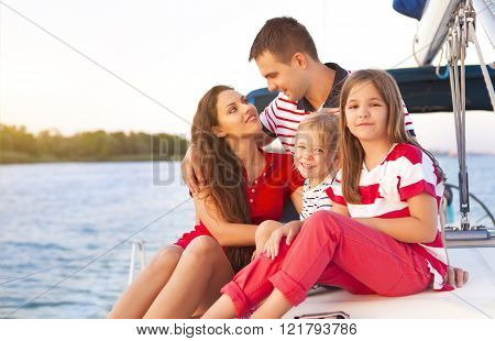 Beautiful Family With Two Daughters Having Great Time At The Yacht