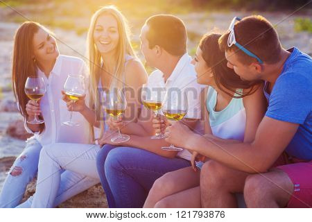 People Holding Glasses Of White Wine At The Beach Picnic