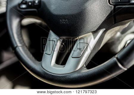 Car inside steering wheel details close up