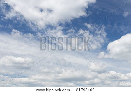Huge curly patterned white clouds in the blue sky during the day without the sun ** Note: Soft Focus at 100%, best at smaller sizes