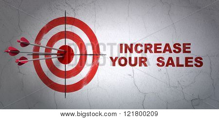 Finance concept: target and Increase Your  Sales on wall background