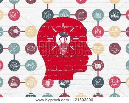 Business concept: Head With Light Bulb on wall background