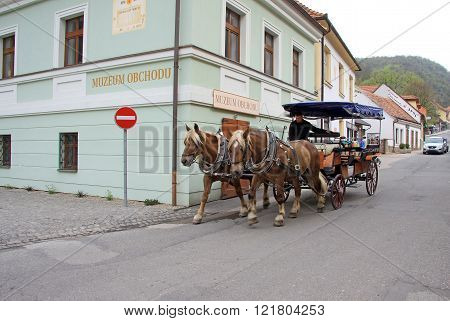 Karlstejn, Czech Republic - April 30, 2013: Horse Carriage  On Main Street Leading To The Karlstein