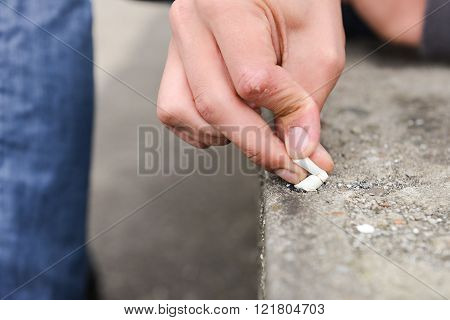 Hand Of A Young Man Extinguish Cigarette On A Stair