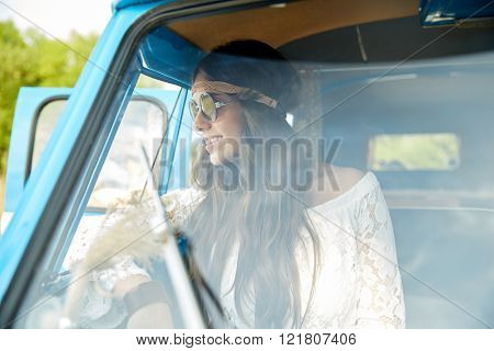 summer holidays, road trip, vacation, travel and people concept - smiling young hippie women in minivan car