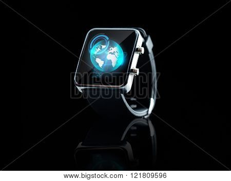 modern technology, object and mass media concept - close up of black smart watch with earth globe projection on screen
