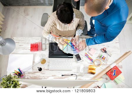 Two employers in designer photo studio processing