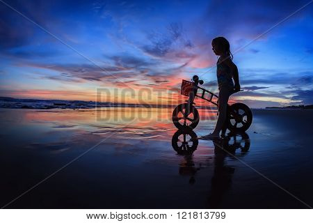 Child With Run Bike On Sunset Beach