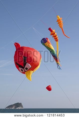 ITALY, LIGURIAN RIVIERA, SPOTORNO, MARCH 2016, colored kites in a windy day in ligurian riviera italy
