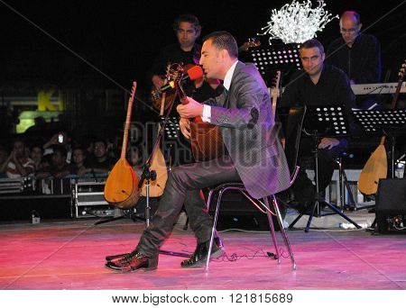 ANKARA/TURKEY-JUNE 8: Folk music singer ?smail Altunsaray at the stage with baglama during the