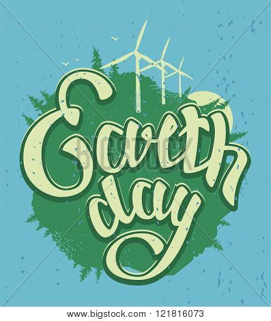 April 22 Earth Day. Green Earth and wind energy. Earth Day lettering text
