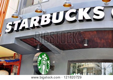 HO CHI MINH VIETNAM - MARCH 24: Starbucks coffeeshop in Ho Chi Minh city centre on March 24 2015. Ho Chi Minh is the secord largest city of Vietnam.