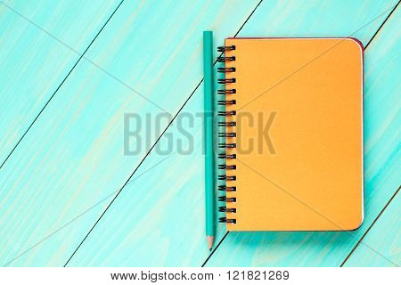 Orange Notebook With Pencil