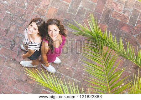 Portrait Of Two Beautiful Girls Taken From Above.