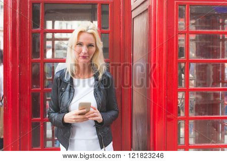 Beautiful Woman Portrait In London With Red Phone Booth