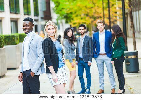 Business Multiracial Couple Looking At Camera