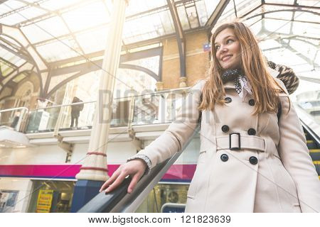 Beautiful Woman On The Escalator At Train Station