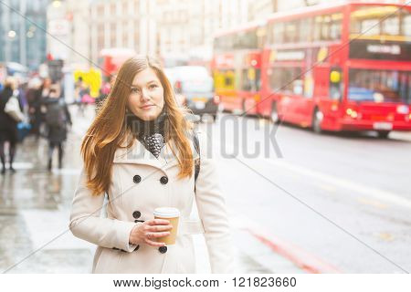 London, Young Business Woman Walking Along The Road