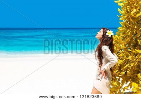 Beautiful Free Woman Enjoying On Exotic Beach In Summer By Tropical Blue Water. Attractive Girl With