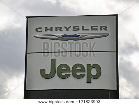 MOSCOW RUSSIA - OCTOBER 10 2015: Logotypes of Jeep and Chrysler corporations on October 10 2015. Jeep and Chrysler are the American automotive manufacturers.