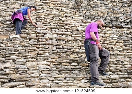 Tourists Descend The Main Pyramid At Tonina Archeological Site In Chiapas, Mexico