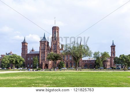 People Visit Smithsonian Castle In Washington Dc