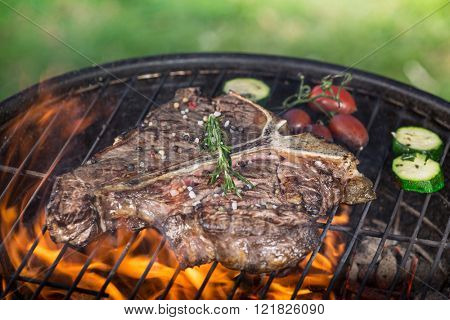 Grilled beef steaks on the grill.
